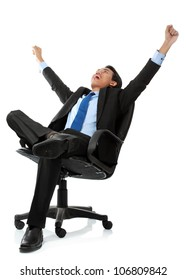 Excited business man with arms raised while sitting - Isolated on white