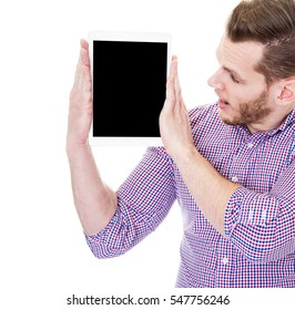 Excited business man showing tablet pc with blank screen isolated on white background