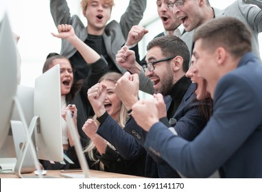excited business team is jubilant in the workplace.