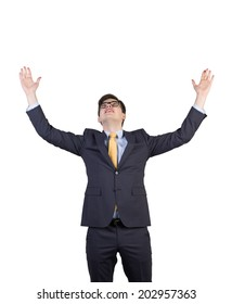 Excited businessman celebrates a career achievement. Isolated on white.