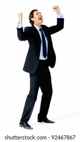 Excited businessman pumps both fists in the air in a celebratory gesture