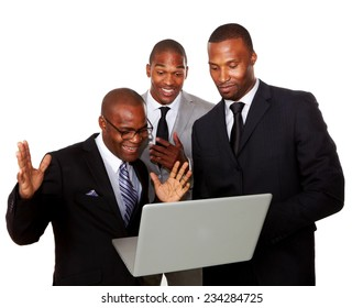 Excited businessmen using laptop isolated over white background