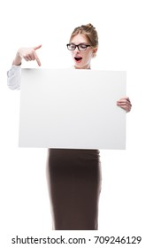 excited businesswoman in formal wear pointing at blank card, isolated on white