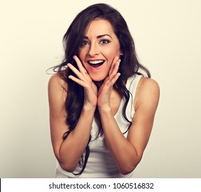 Excited casual surprising woman in white short with big eyes and open mouth with hand near the face looking. Toned vintage portrait