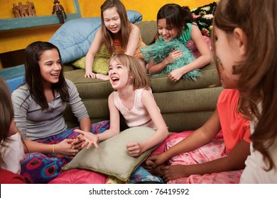 Excited Caucasian girl with her happy friends at a sleepover