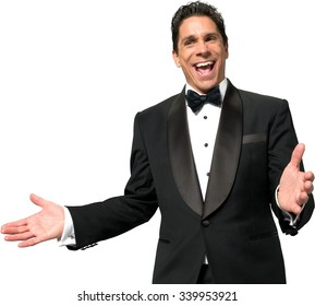 Excited Caucasian man with short black hair in a tuxedo talking with hands - Isolated
