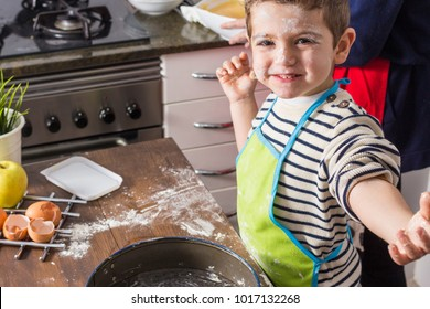 Excited child spotted with flour at kitchen
