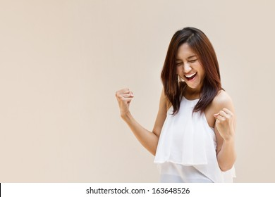 excited confident girl, happy confident woman laughs; fun laughing girl, joyful woman, happy asian woman, happy laughing smiling people concept; portrait of confident asian woman, isolated background