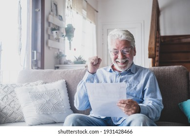 Excited elderly man celebrate health insurance deal closing looking and reading the medical results. Happy mature senior feel overjoyed make sign good bank agreement with specialist. Checking outcomes