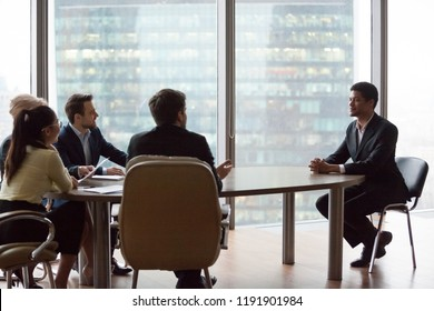 Excited employers satisfied with African American candidate resume, impressed HR managers talk to black male applicant at office hiring, confident employee make good first impression at interview