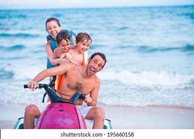 Excited family riding jet ski