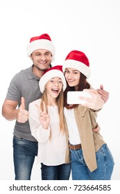 excited family in santa hats taking selfie on smartphone, isolated on white