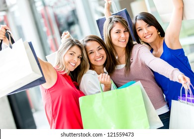 Excited female shoppers at the shopping center