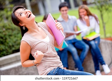 Excited female student celebrating the end of the school year