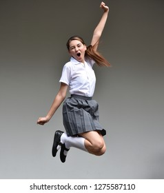 Excited Female Teenager Jumping
