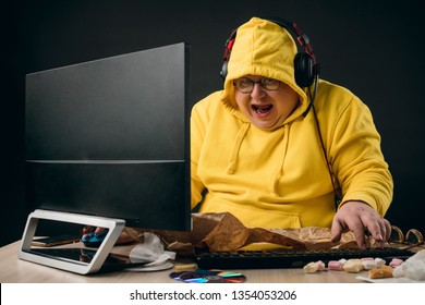 ea2c39986c excited funny plump man in trendy clothes surfing the net. close up  portrait