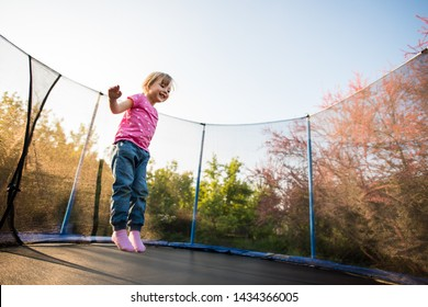 Excited girl enjoying the bounce off the trampoline