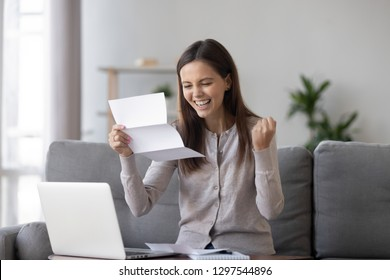 Excited girl student customer holding mail paper letter bank statement feels happy reading great news about admission scholarship, get accepted hired new job employment opportunity, good test results