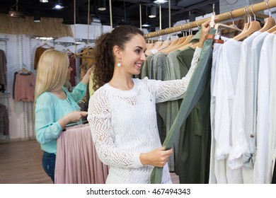 Excited girls looking for new garments at the store