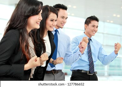 Excited group of business people celebrating success