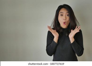 excited happy girl woman expression, amazed woman, surprised asian woman looking at you or camera, casual girl portrait studio isolated, excited happy people concept, beautiful girl asian woman model