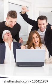 excited happy group of friends winning in trade stock using laptop smiling