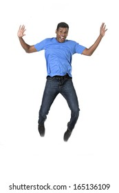 Excited Indian man jumping for joy. Isolated on white background.