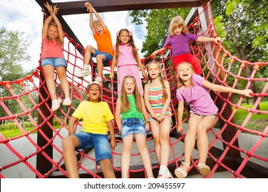Excited kids playing together on net ropes