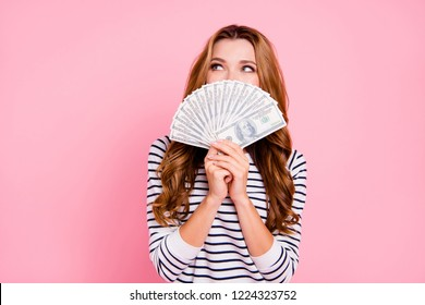 Excited lady in striped wear with her modern hairstyle she hide cover close face by much money look aside think thoughtful isolated on pastel pink background