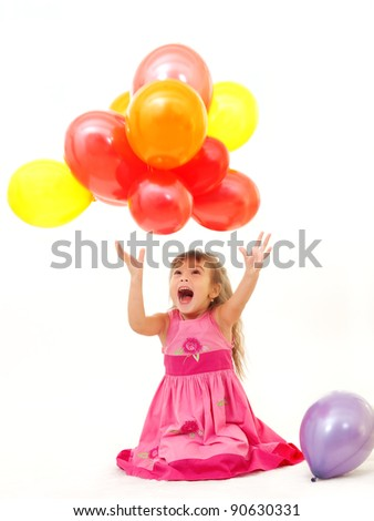Excited Little Girl Catching A Bunch Of Her Colorful Birthday Balloons