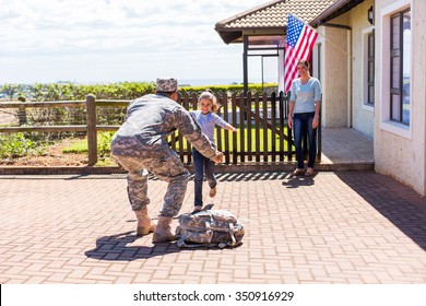 excited little girl running to her military father