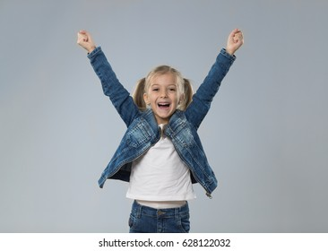 Excited Little Teenage Girl Hold Hands Up, Small Happy Smiling Child Isolated Over Gray Background