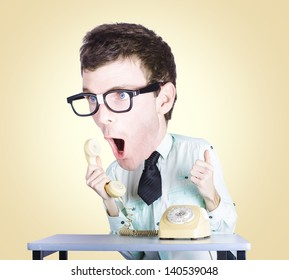 Excited male employee of the month shouting out with enthusiasm and excitement when communicating to customers with his enlarged head