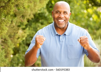 Excited man clenching his fists