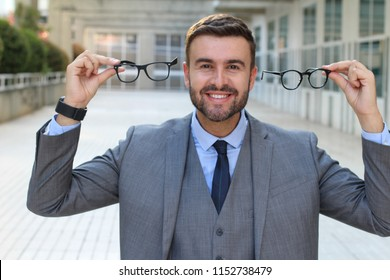 Excited man getting a 2x1 eyeglasses offer