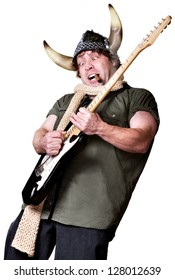 Excited man in scarf and viking helmet playing guitar