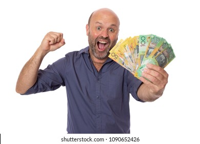 An excited man showing a wad of cash.