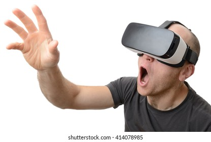 Excited man using a VR headset and experiencing virtual reality isolated on white background
