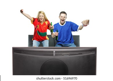 Excited man and woman watching sport on a TV isolated on white background