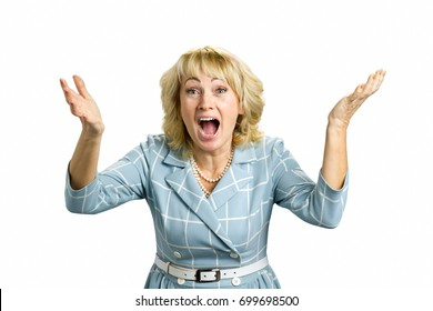 Excited mature woman, white background. Surprised astonished white-skin woman. Closeup portrait woman looking surprised in full disbelief on white background.