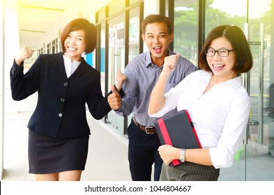 Excited middle aged asian business team