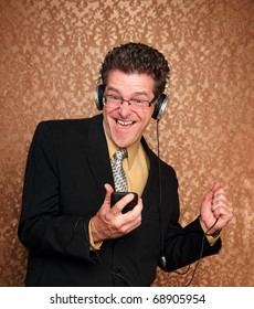 Excited middle aged Caucasian male listens to music on his MP3 player