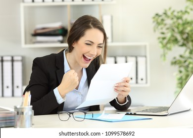 Excited office worker reading good news in a letter