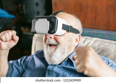 excited old man looking through VR goggles