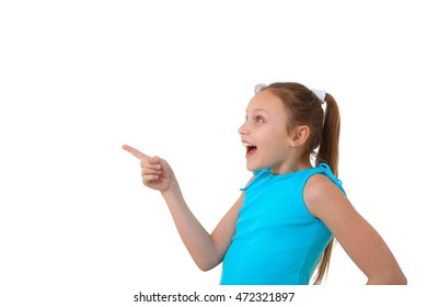 excited preteen girl pointing at copy space on white background