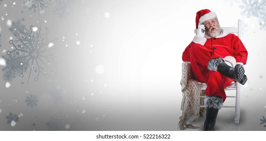 Excited Santa Claus talking on mobile phone against snowflake pattern