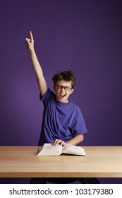 Excited School Boy With Glasses
