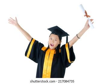 Excited school kid in graduation gown.