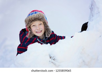 excited smiling boy ready for sledding, enjoying winter fun activities