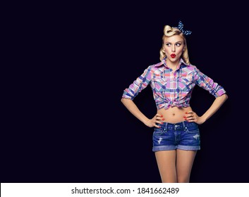 Excited surprised pinup woman. Girl in pin up style, looking sideways. Blond model at retro fashion and vintage concept. Black background. Copy space for advertise slogan, imaginary or ad text.